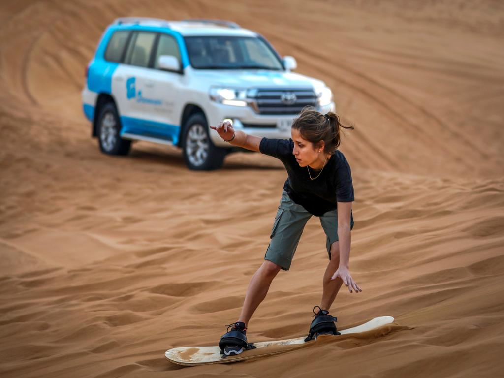 Morning Desert Safari, Sandboarding and Camel Ride